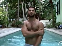 Hot lanose guy relating near the pool and shower
