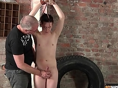 Interesting boy in bondage stroked by his master