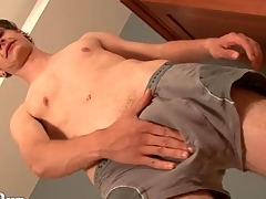 Dispirited young twink models his asshole for us
